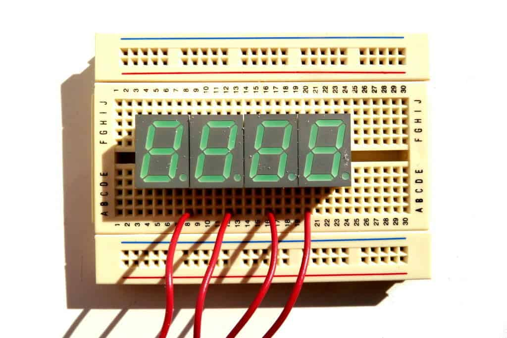 A breadboard with 7 segment displays attached